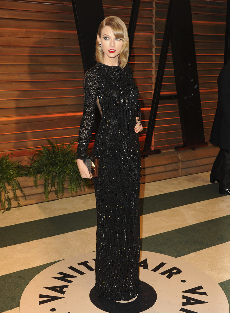 Taylor Swift Wore A Julien Macdonald Dress Emm Kuo Clutch Tamara Mellon Shoes And Lorraine Schwartz Jewelry Vanity Fair Oscar Party Hosted By Graydon
